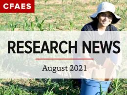 Researcher Ana Trabanino Pino smiling in field with samples under newsletter title, Research News - August 2021