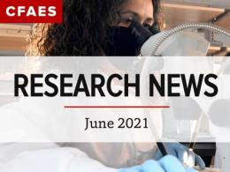 Scientist looking into a microscope under the Newsletter Title - Research News for June 2021