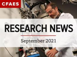 Researcher in lab with large equipment under newsletter title, Research News - September 2021